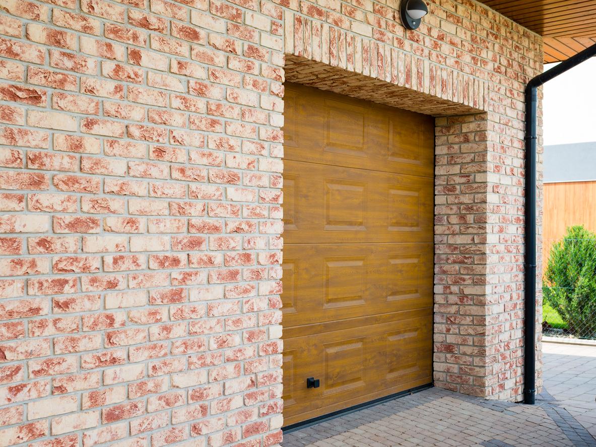 Wooden Garage Door with brick wall background